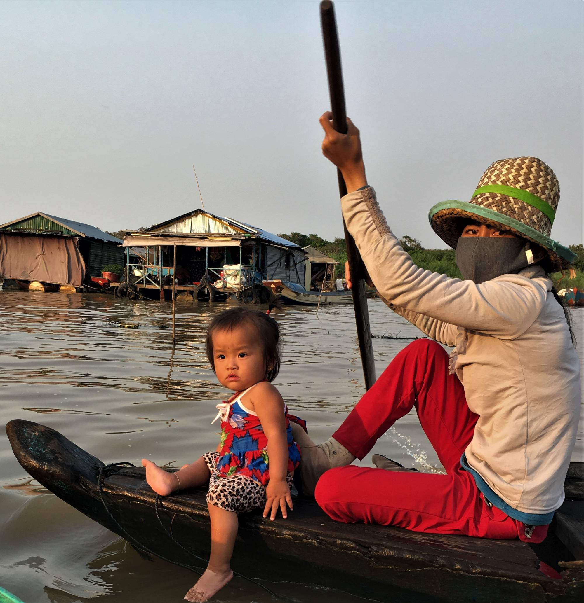 adult and child in boat on river